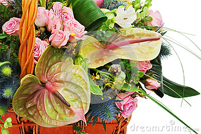 Fragment of flower bouquet in wicker basket isolated on white ba