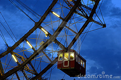 Fragment of giant ferris wheel under dramatic sky