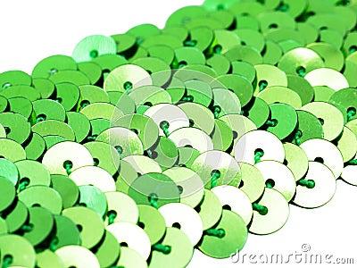 Fragment of green spangle ribbon close-up