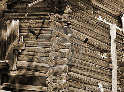Fragment of house in Russian village. Sepia.