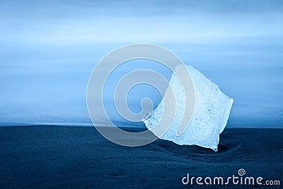 Fragment of iceberg on the beach near Jokulsarlon, Iceland