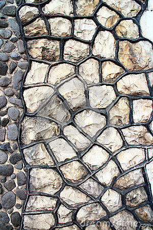 Fragment of an modern handmade stone wall as backgrounds.