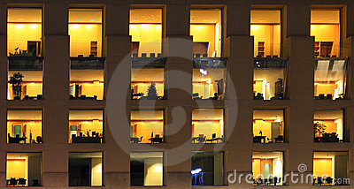 Fragment of modern office building at night