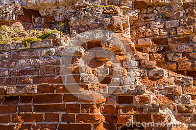 Fragment of old brick wall