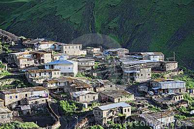 Fragment of village in mountains