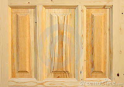 Fragment wooden door made of coniferous tree