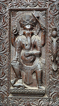 Fragment of wooden nepalese door with Ganesha