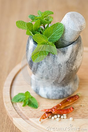 Fragrant mint in a ceramic mortar and spices
