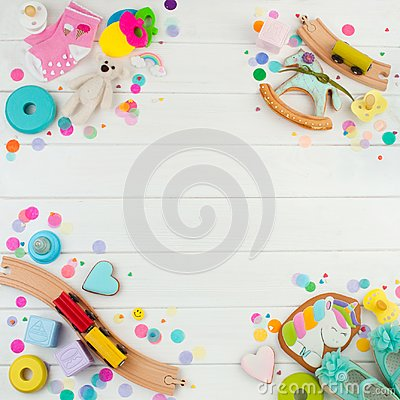 Free Frame From Baby Accessories And Toys On White Wooden Background Stock Photography - 113433602