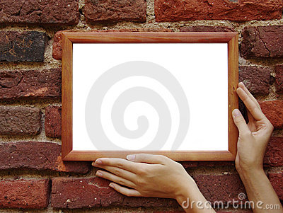 Frame in hands on grunge wall