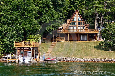 A-Frame House on Water with Boats
