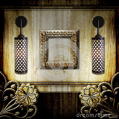 Frame and lamps on wooden background