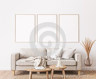 Frame mockup in farmhouse living room design, white furniture on bright wall background Stock Photo