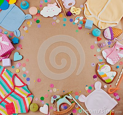Free Frame Of Baby Clothes And Accessories On Craft Paper Background Royalty Free Stock Images - 113433659