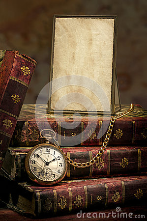 Frame with old photo paper, pocket watch and books