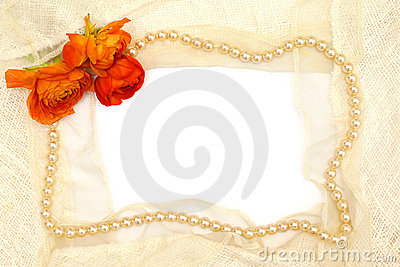 Frame from orange flower, pearls and lace