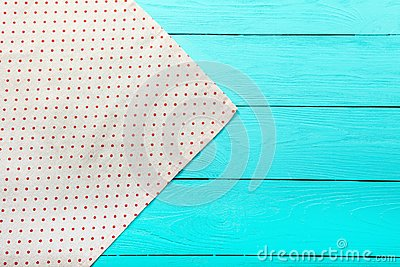 Frame of polka dots texture on blue wooden table. Top view and copy space. Mock up Stock Photo