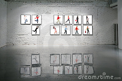 Frames with walking people on white brick wall