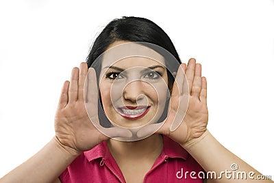 Young woman framing face