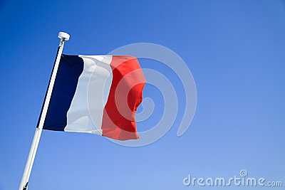 France flag waving with clear blue sky