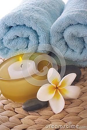 Frangipani,candle and towel on mat