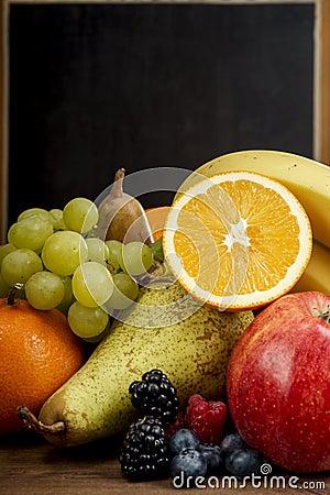 Free Frash Fruit, Orange, Apple, Banana, Pear, Grapes Against Blackboard Royalty Free Stock Images - 50481289