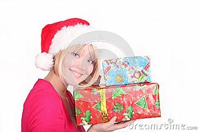 frau welche die weihnachtsgeschenke tragen sankt ha. Black Bedroom Furniture Sets. Home Design Ideas