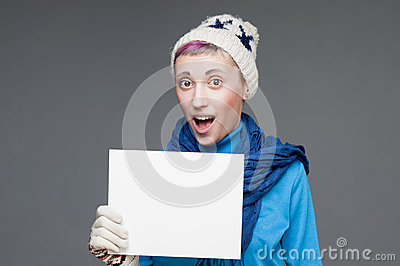 Freaky girl in winter clothing holding sign