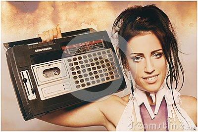 Freaky woman with old fashioned tape recorder