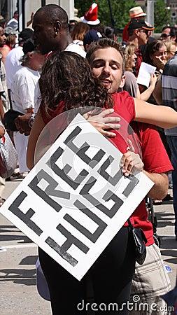 Free Hugs Guy Hugging Woman Editorial Photo