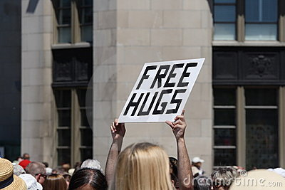 Free Hugs Sign Being Held Up Editorial Photography