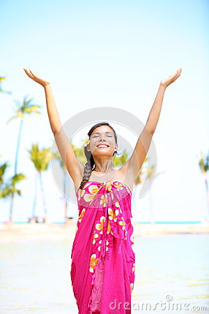 Free spiritual woman on hawaii on beach