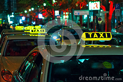 The free taxi on the night street near Potsdamer P Editorial Stock Image