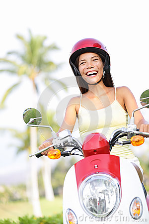 Free woman riding scooter happy