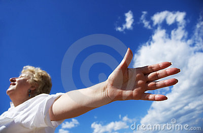 Free woman on the sky background
