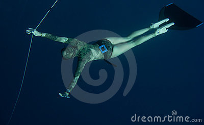 Freediver is waiting for someone in the depth