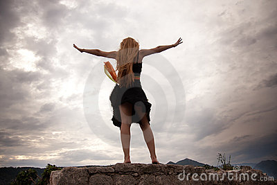 Freedom concept - woman on mountain peak