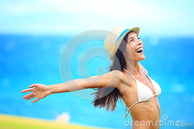 Freedom - free young woman happy on beach