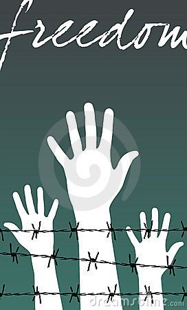 Freedom: hands behind a barbed wire prison