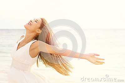 Freedom woman in free happiness bliss on beach