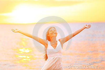 Freedom woman happy and free open arms on beach