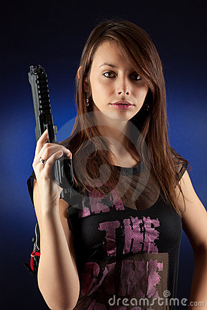 Freestyle woman posing with guns