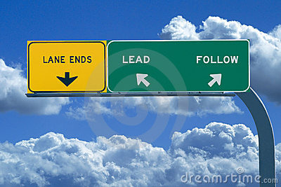 Freeway sign reading Lead or Follow