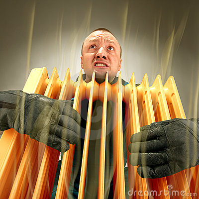 Freezing man holding hot oil radiator