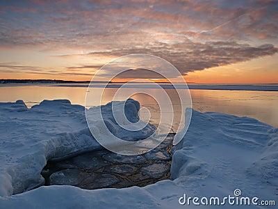 Freezing sea shore in the romantic evening light