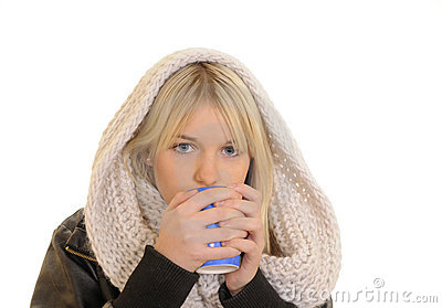 Freezing woman drinking