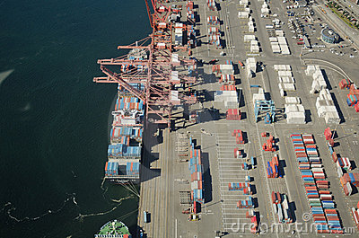 Freight Ship Unloading at Dock Editorial Image