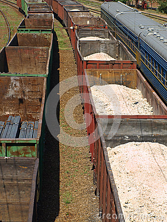 Freight trains of metal profile and sulfur.