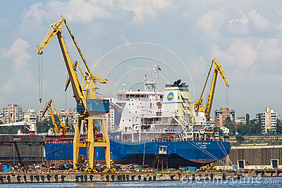 Freighter ship and cranes Editorial Image