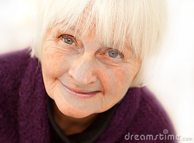 Freindly older mature woman on white background